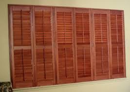 wood plantation shutters image sunburst shutters sunburst shutters