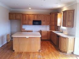 painting oak cabinets white before and after painting kitchen cabinets white beneath my heart