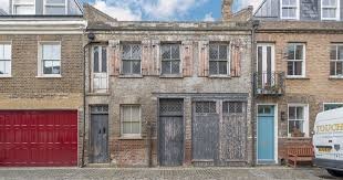 Beautifully derelict mews house in street lived in by Sid Vicious