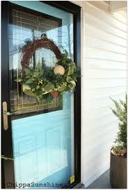 Christmas Decorations To Hang In Window by 3 Ways To Hang A Wreath On A Storm Door