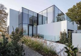 the squeaky clean glass house by a lake home design find