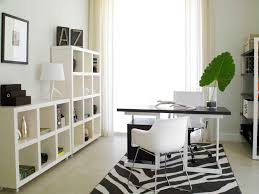 small office interior with light green wall paper combined with