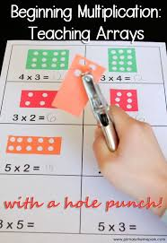 teaching multiplication arrays with a hole punch teaching