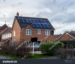 house with solar house solar panels on roof stock photo 630514190