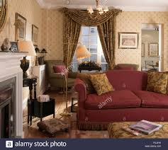Living Room With Red Sofa by Red Patterned Wallpaper And Red Sofa In A Nineties Living Room