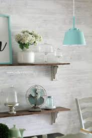 aqua dining room dining room accents graphic blue wallpaper and brass in the