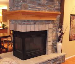 interior light wooden fireplace mantels with brick fireplace and