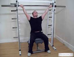 watch u201cseated barbell reverse shoulder press with wide grip u201d on