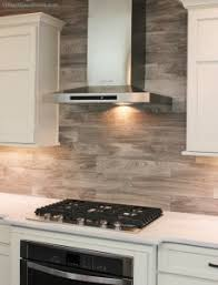 wood backsplash kitchen a wood look flooring tile installed in a kitchen backsplash this