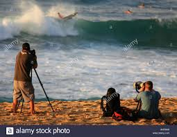hawaii photographers photographers at surf competition sunset shore oahu