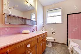 pink old bathroom interior with tub and sink countertop stock