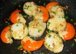 cuisiner les noix de jacques noix de st jacques poêlées à l ail et ciboulette