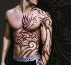 cool tribal placement idea at front for guys tattoomagz