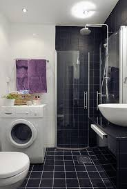 bathroom wash machine and tile shower walls with vanity for