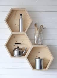 living room natural unvarnished white wall floating shelves