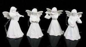 set of 4 white porcelain ornaments ornaments