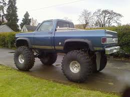 monster trucks mudding videos images for u003e chevy trucks jacked up with stacks chevrolet rocks