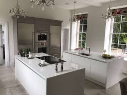 Shiny White Kitchen Cabinets White Kitchen Design With Double Kitchen Island Dressed In Glossy