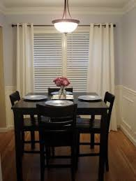 small dining room sets table against the wall two chairs one bench seat seating for