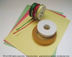 rolled paper ornaments paper plate and plane