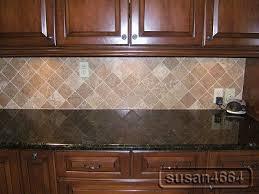 dark granite with cherry cabinets and backsplash kitchen ideas