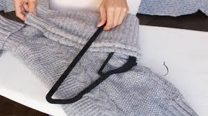 how to hang your sweaters without ruining them