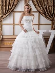 strapless tiered wedding dress with heart shaped beading