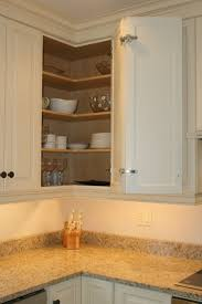 pretty pale brown color wooden corner kitchen cabinets features