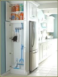 storage cabinets for mops and brooms utility closet size broom storage cabinet amazing and mop house buy