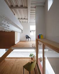 balconies and courtyards puncture japanese apartment building by