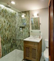bathroom mosaic tile wall with doorless shower and graff faucets