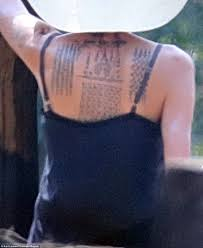 angelina jolie debuts new tattoos and directs khmer rouge film in