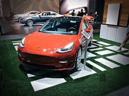 tesla showcases model 3 in rare la auto show appearance as exhibitor