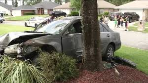 teen driving stolen car damages home crashes into tree