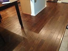 brown color vinyl wood plank flooring in kitchen with small