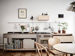 restaurant style kitchen faucet steal this look smart storage in a swedish kitchen remodelista