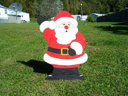 waving santa claus outdoor wood yard lawn