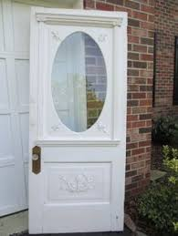old glass doors a black door with a large oval window is what i would like for