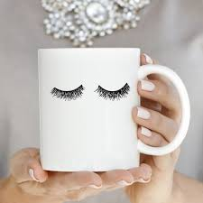 eyelashes gold coffee mug coffee water and hand drawn
