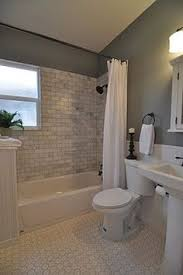 bathroom ideas on a budget the molding around the shower opening and use of two curtains