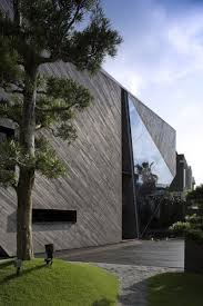 architecture wooden cladding exterior design ang triangle glass cut