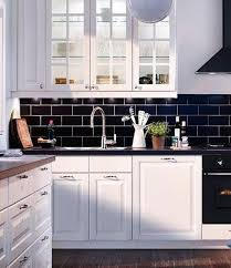 black kitchen cabinets with white subway tile backsplash 35 ways to use subway tiles in the kitchen digsdigs