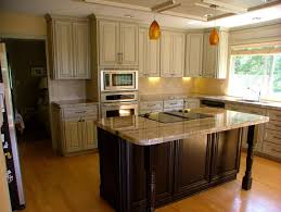 kitchen with dark cabinets and light granite stone tiles