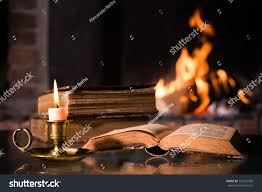 open bible burning candle front fireplace stock photo 165712469