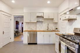 backsplash white kitchen with white subway tile modern white