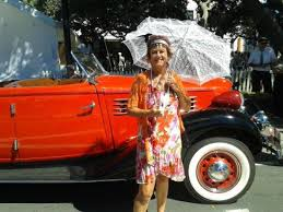 in front of one of many vintage cars on display at art deco feb 15