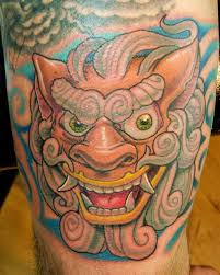 orange foo dogs 32 breathtaking foo dog tattoos for inspiration tattoos era