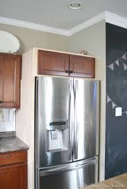 gap between fridge and cabinets building in a fridge with cabinet on top from thrifty decor