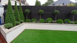 rendered wall but without capping note colour of wooden fence too