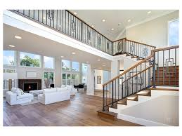 Black Banister Bright Coastal Cottage French Door Staircase Open Floor Plan Wood